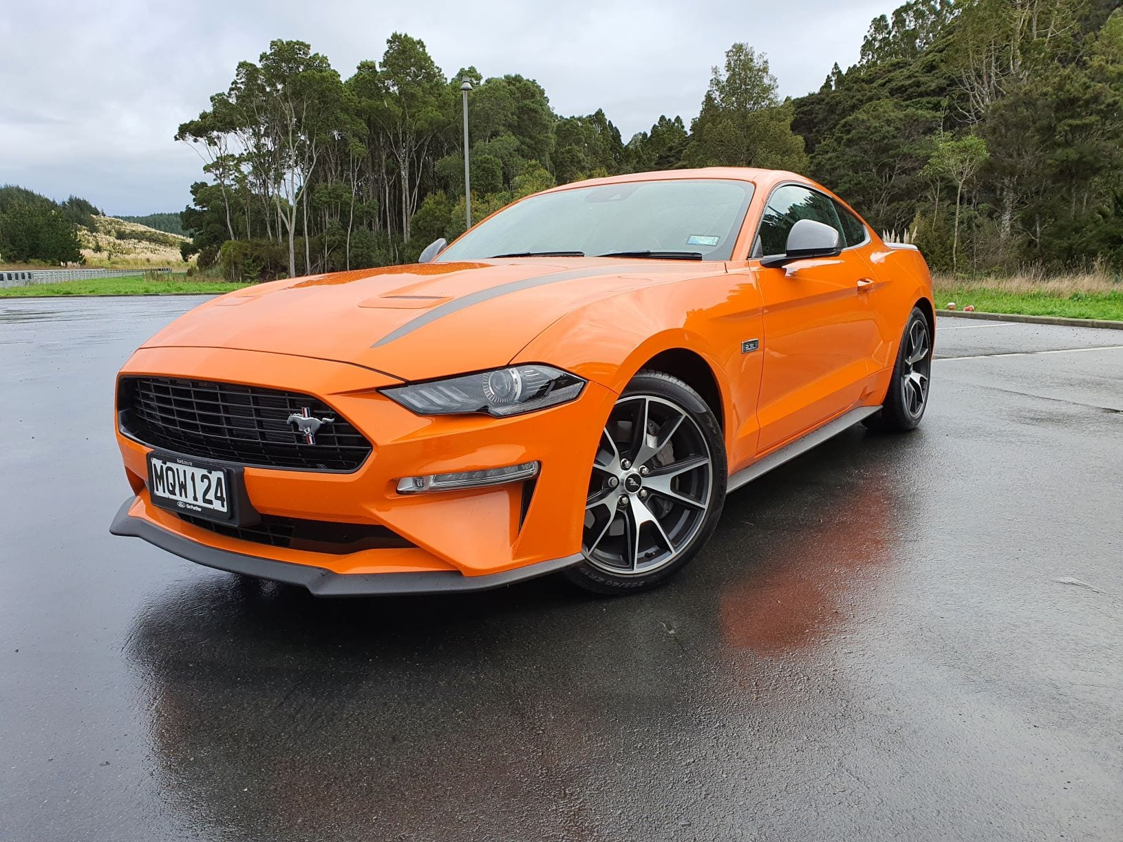 A frontal view of the 2.3L turbo Ford Mustang in bright orange