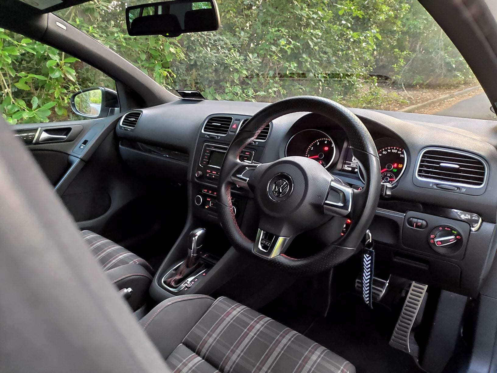 Look at those tartan seats and the red stitching, how could you not want this in your life?! The interior of the Volkswagen Golf GTI.