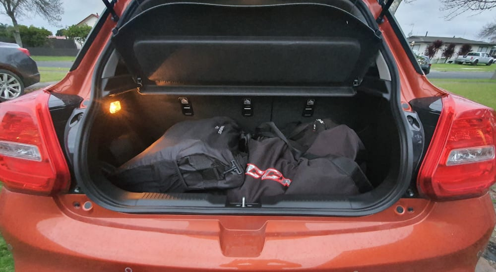 Ice hockey bag and a pram in the boot