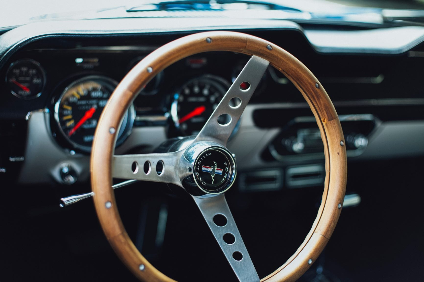 The interior of a classic Ford Mustang.