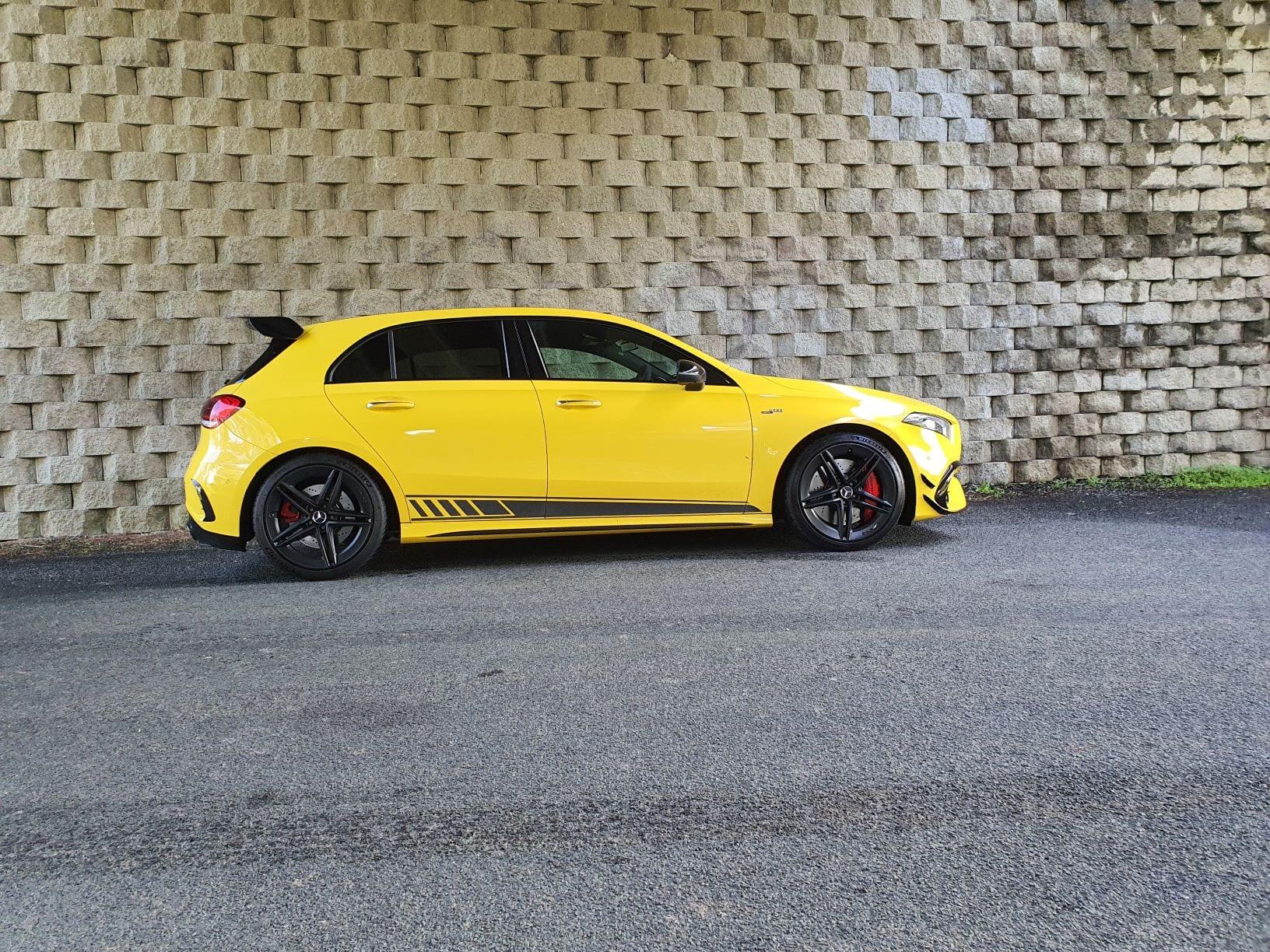 A side view of the Mercedes A45 S AMG edition 1 in yellow