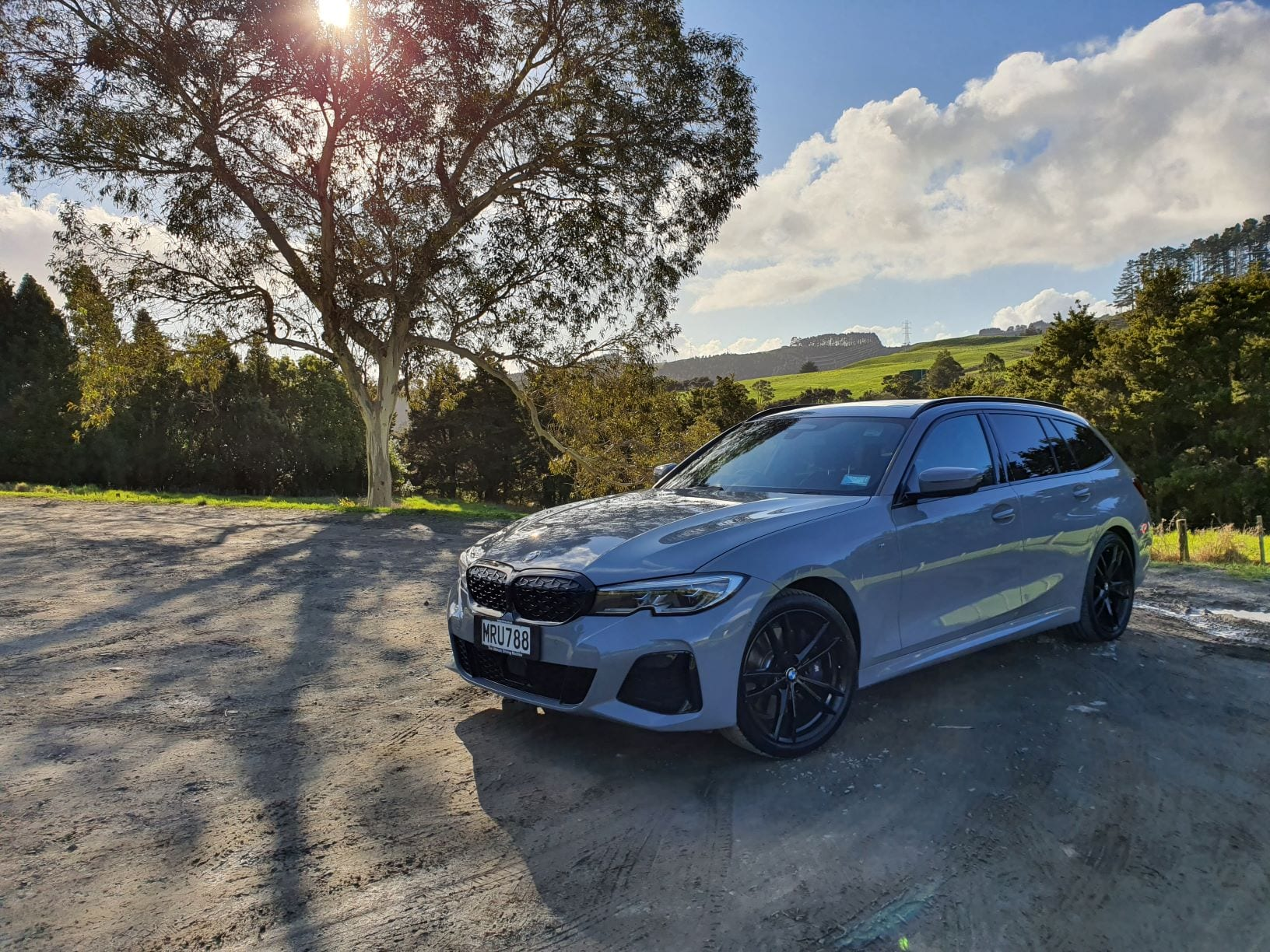 The M340i Touring pictured by a tree