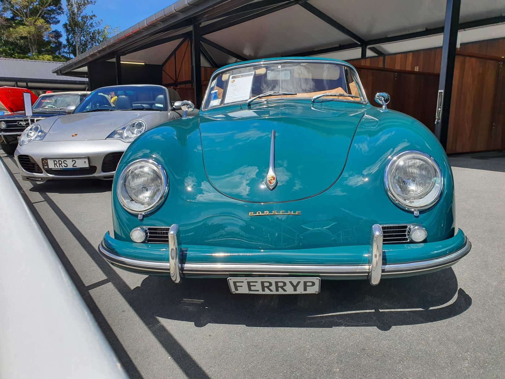 Two Porsches including a turquoise 356A Spider