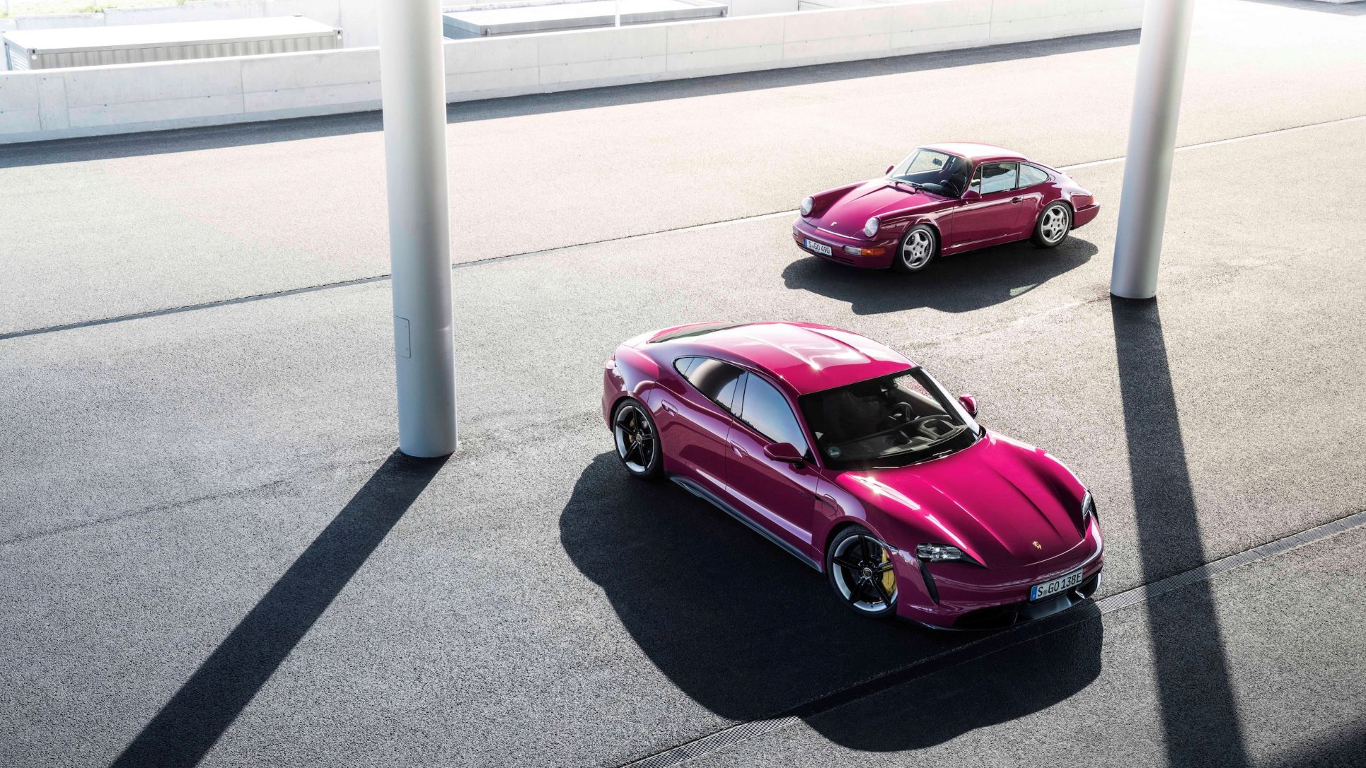 Porsche Taycan and 911 in Rubystone Red