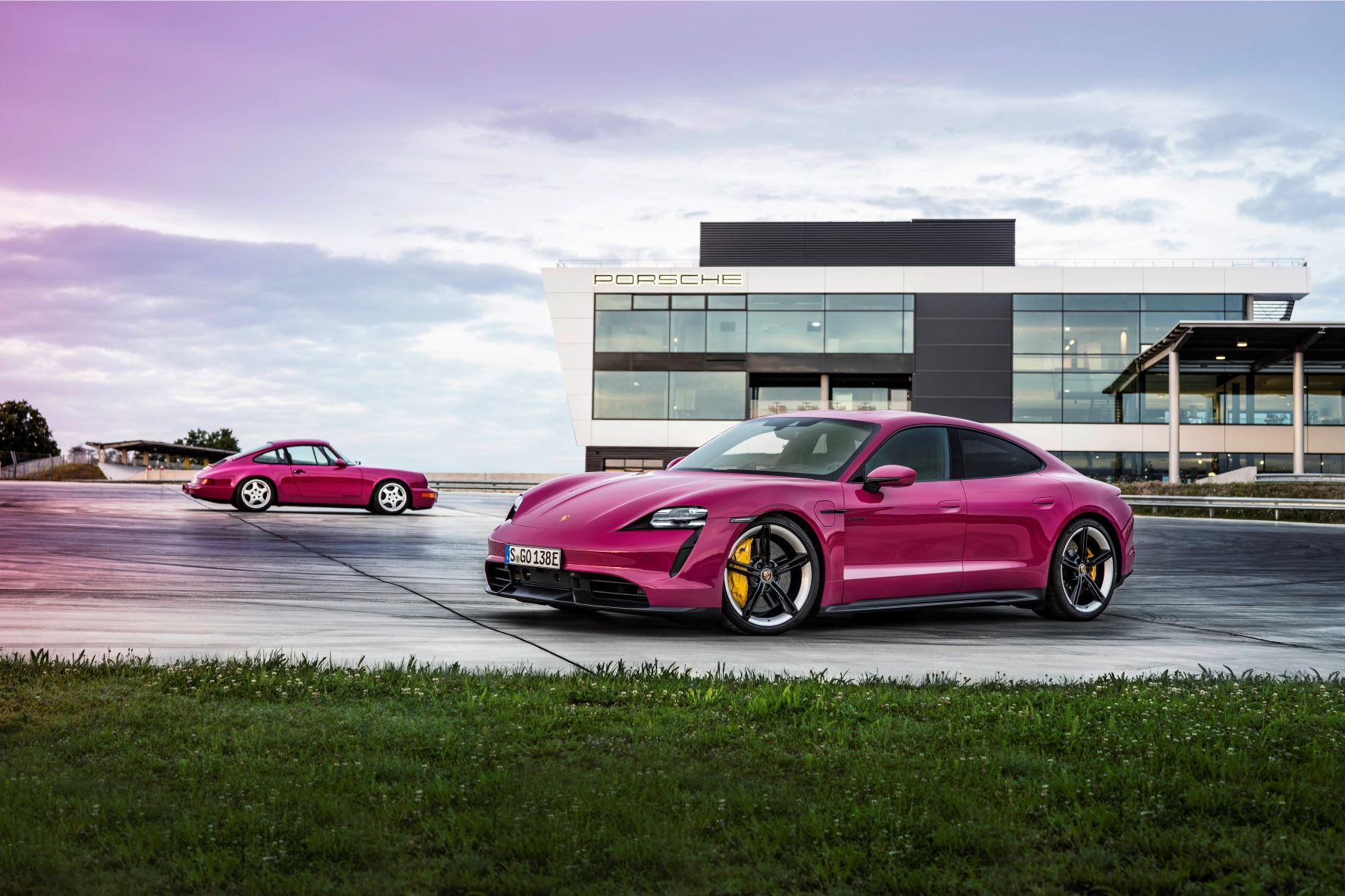 Porsche Taycan and 964 911 in Rubystone Red