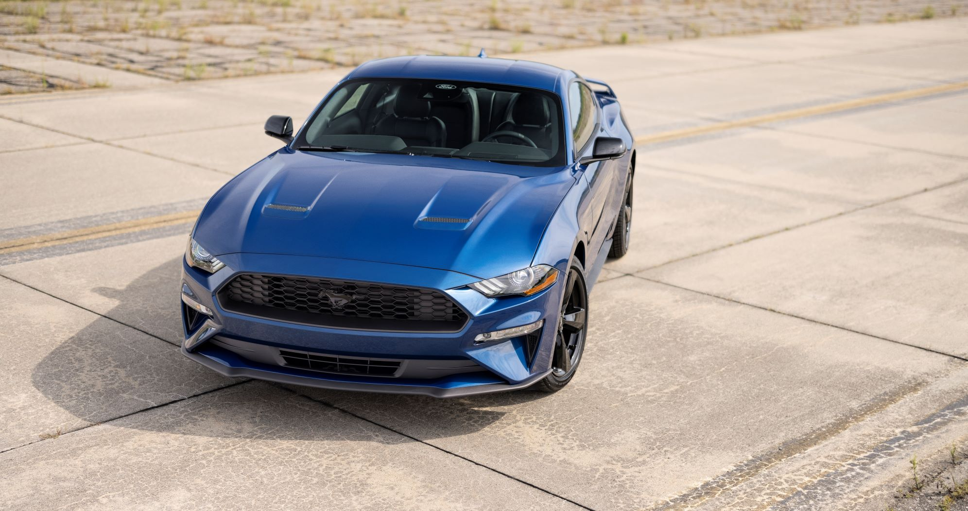Front three quarter view of the 2022 Ford Mustang Stealth Edition in Atlas Blue